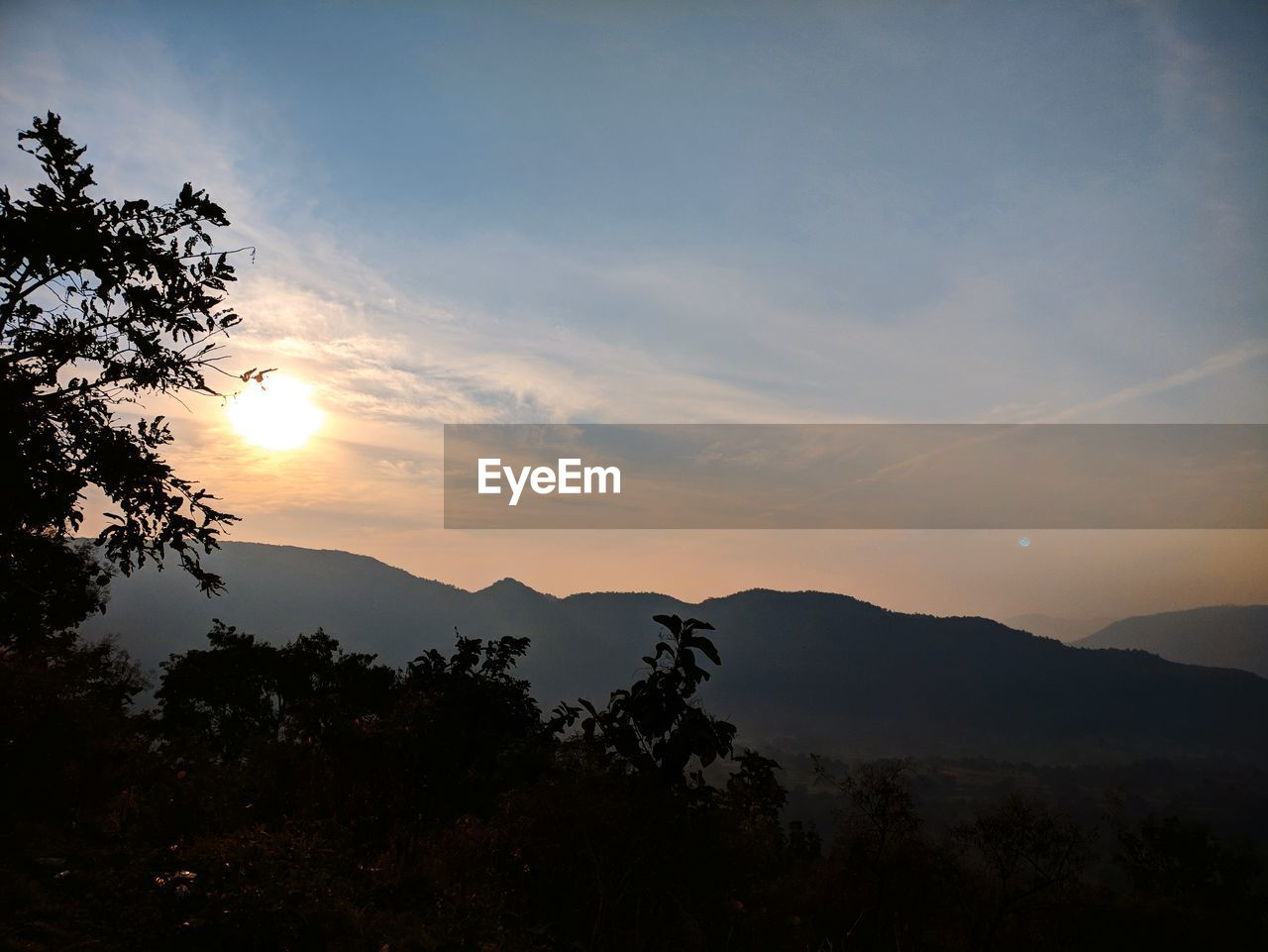 sunset, silhouette, mountain, tree, beauty in nature, nature, tranquil scene, tranquility, scenics, sky, no people, idyllic, sun, mountain range, landscape, outdoors