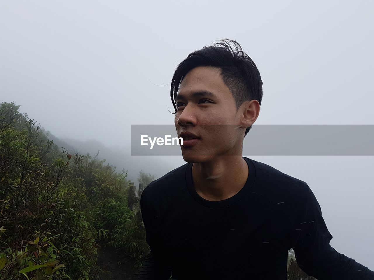Young Man Against Mountain During Foggy Weather