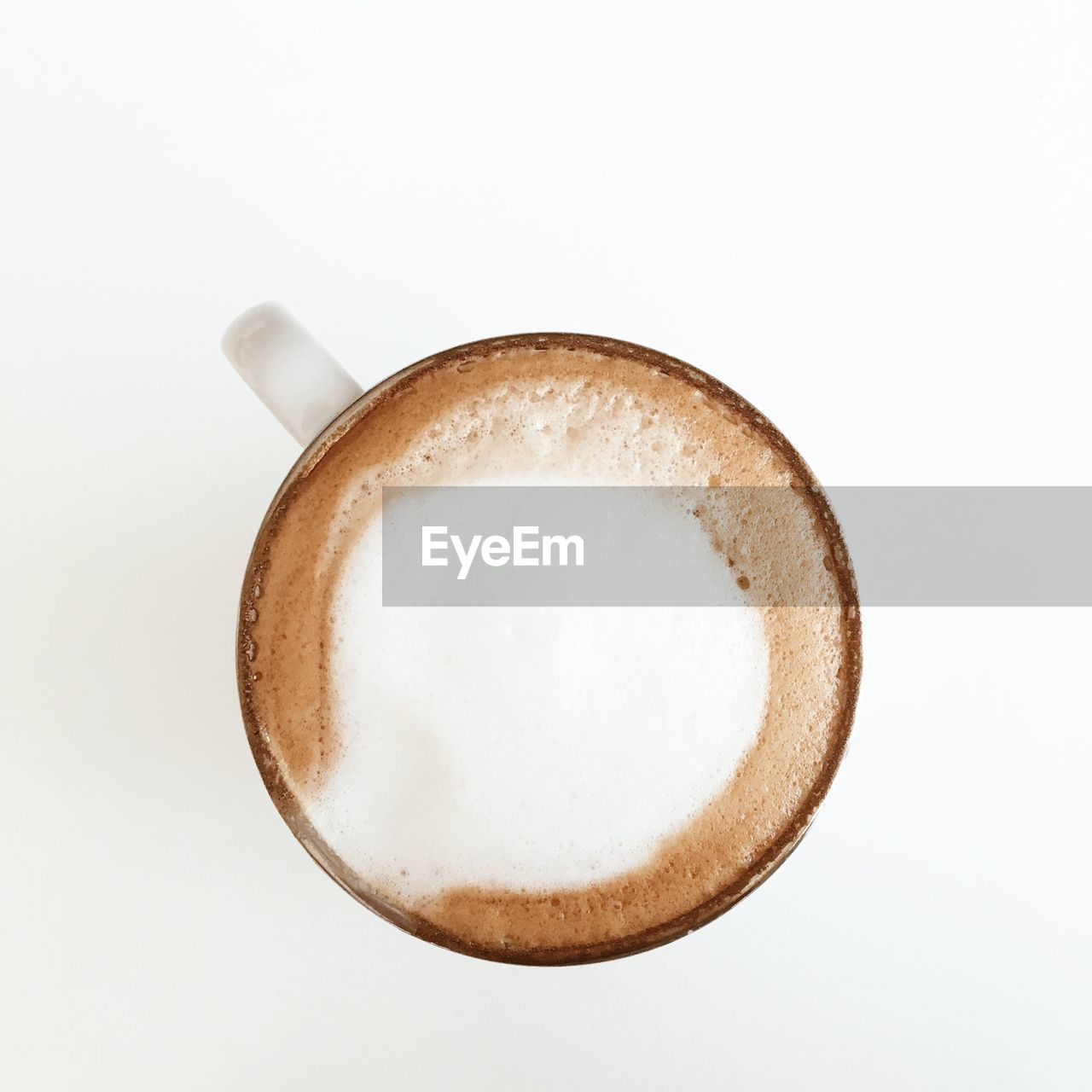 Directly above shot of coffee in cup on white background