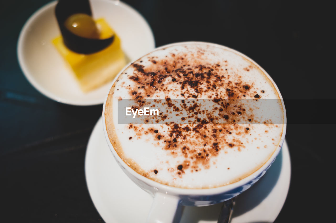 coffee, coffee - drink, drink, cup, coffee cup, mug, food and drink, refreshment, still life, frothy drink, close-up, hot drink, indoors, no people, high angle view, table, cappuccino, freshness, saucer, crockery, froth