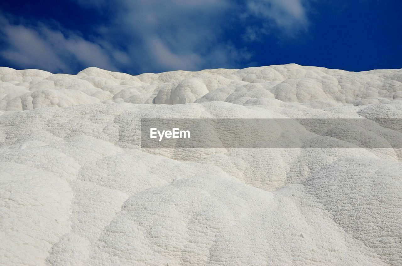 Scenic view of limestones pamukkale against sky