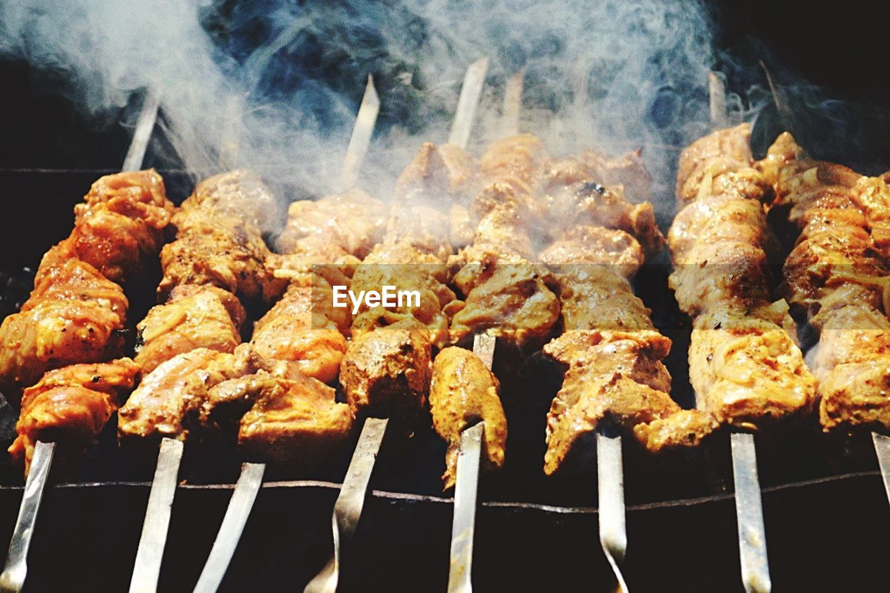 food, food and drink, meat, smoke - physical structure, barbecue, freshness, skewer, grilled, ready-to-eat, close-up, no people, preparation, kebab, heat - temperature, still life, barbecue grill, chicken meat, wellbeing, high angle view, indoors, fried, preparing food, snack, temptation