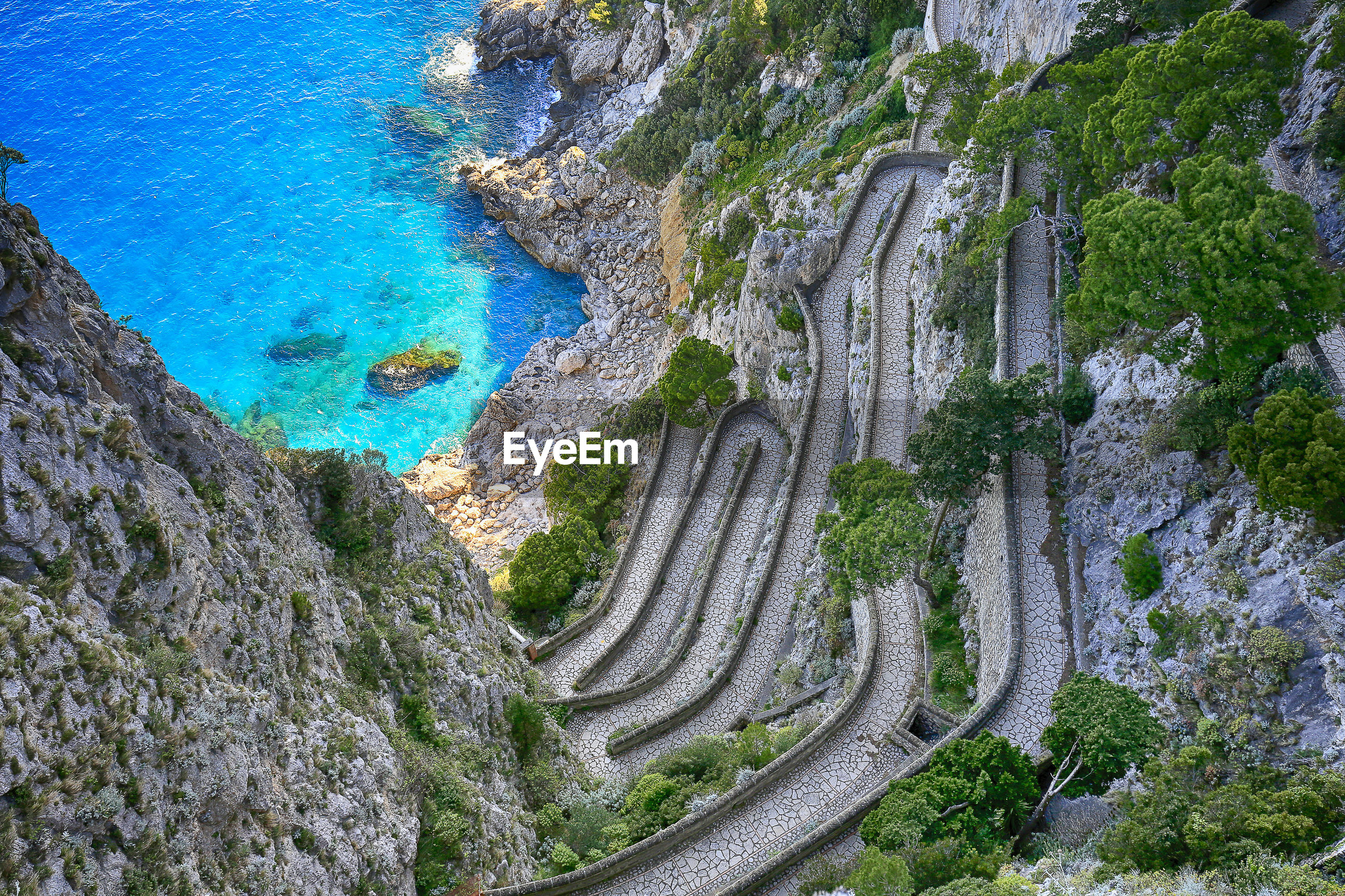 High angle view of curvy road leading to beach