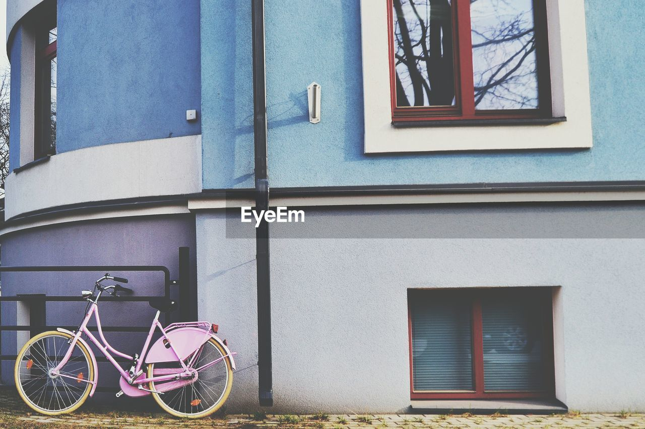 BICYCLE BY WINDOW OF HOUSE