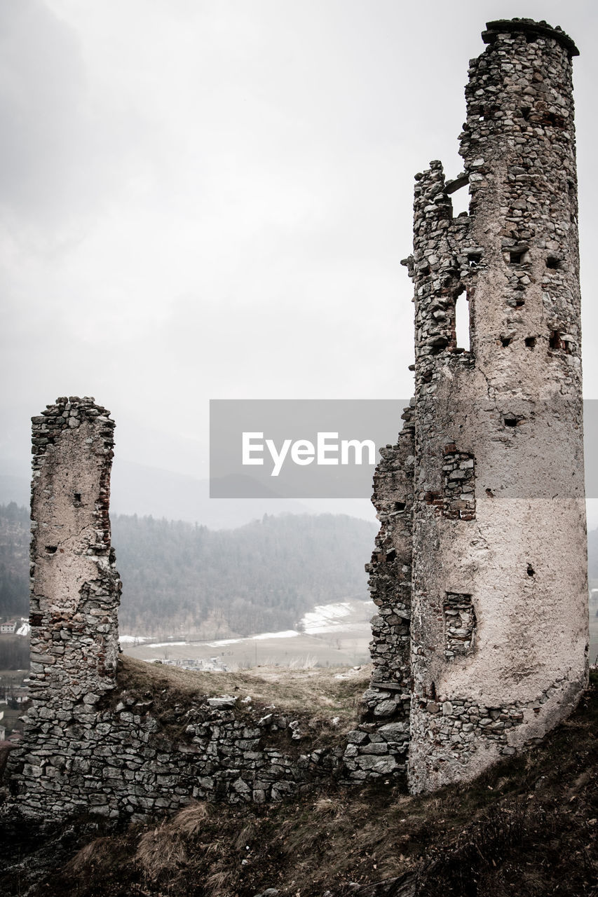 architecture, history, built structure, building exterior, sky, the past, old, building, no people, nature, day, wall, old ruin, fort, abandoned, ancient, castle, outdoors, mountain, damaged, deterioration, stone wall, ruined, ancient civilization