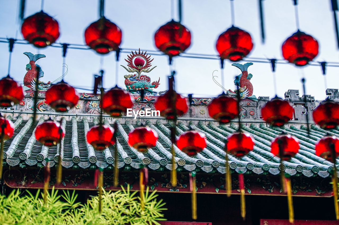 hanging, red, decoration, no people, lighting equipment, focus on foreground, in a row, close-up, celebration, holiday, chinese lantern, day, side by side, large group of objects, low angle view, lantern, outdoors, chinese new year, electric lamp
