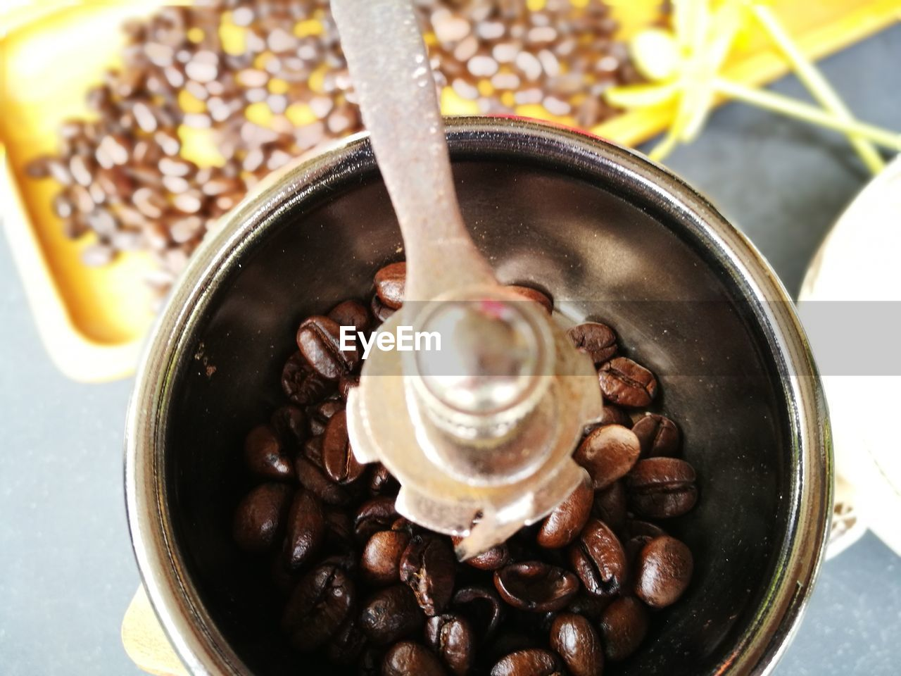 HIGH ANGLE VIEW OF DRINK IN CONTAINER WITH SPOON