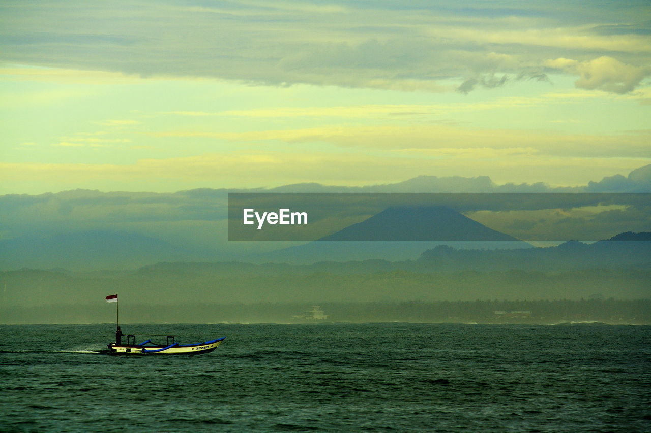 water, transportation, scenics, mountain, nature, beauty in nature, mode of transport, outdoors, sky, nautical vessel, sunset, no people, day