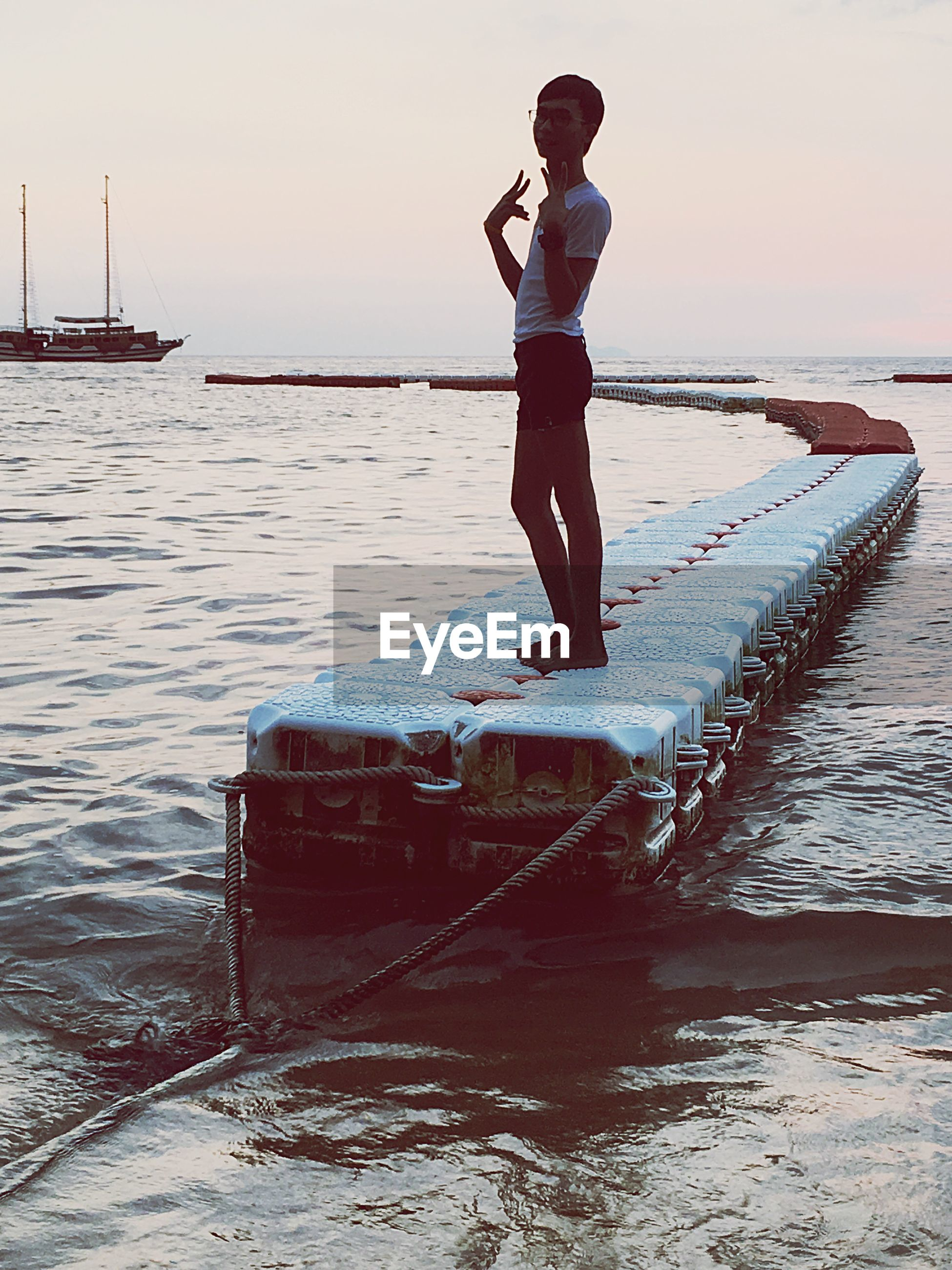water, sea, nautical vessel, full length, rear view, lifestyles, leisure activity, pier, standing, clear sky, sky, casual clothing, horizon over water, beach, boat, transportation, shore, men