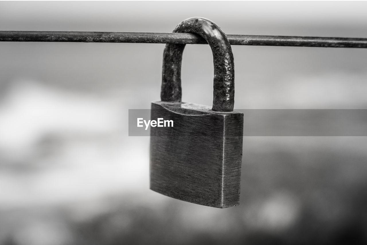 Close-up of padlock on railing