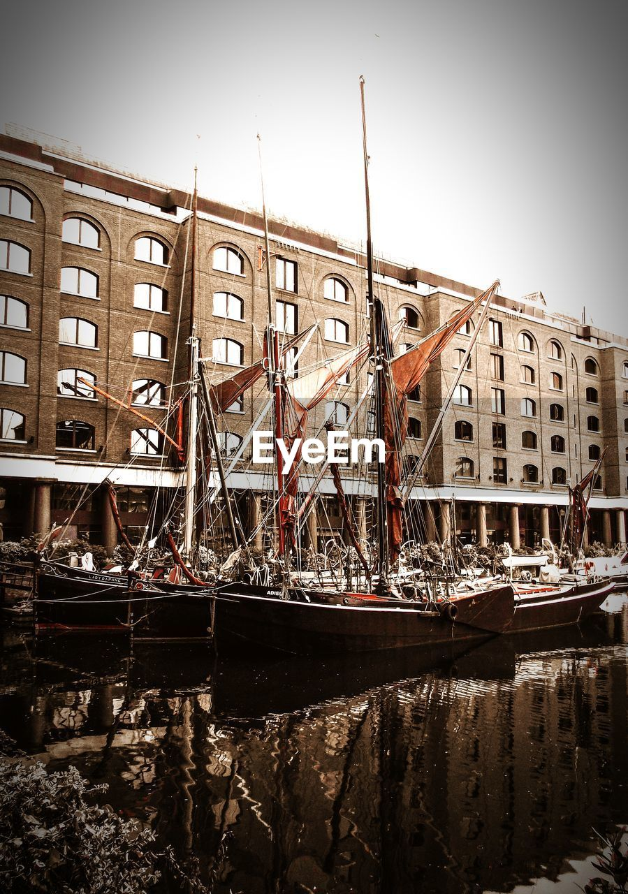 nautical vessel, transportation, water, mode of transport, moored, built structure, architecture, waterfront, day, no people, outdoors, building exterior, mast, clear sky, nature, sky