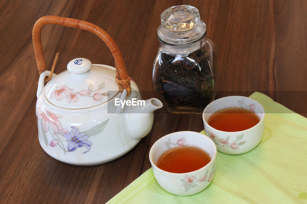 table, food and drink, container, drink, cup, refreshment, teapot, tea, hot drink, indoors, tea - hot drink, mug, no people, still life, food, close-up, crockery, tea cup, freshness, high angle view