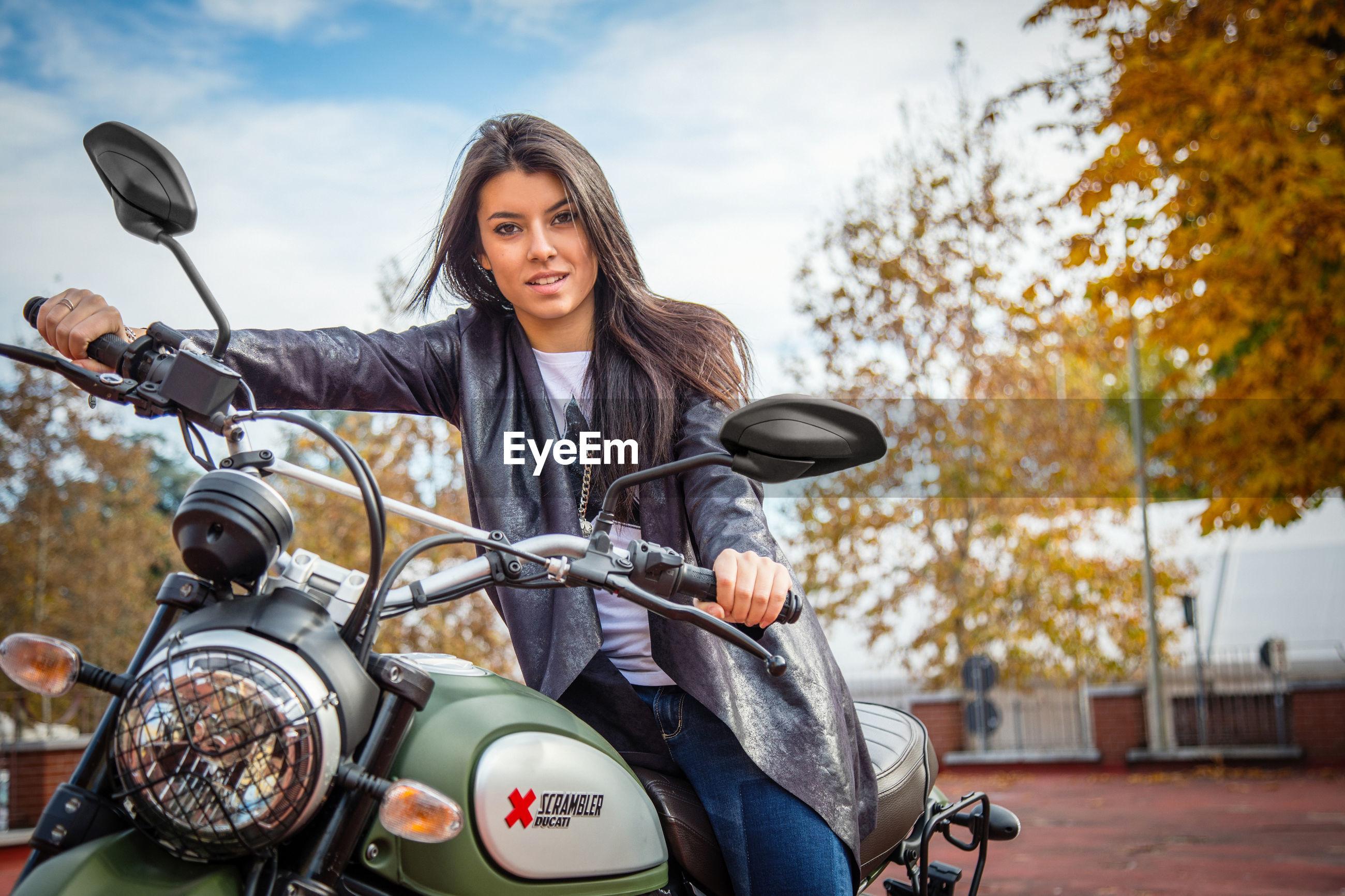 Young Woman On A Ducati Scrambler Beautiful Woman Eyeem
