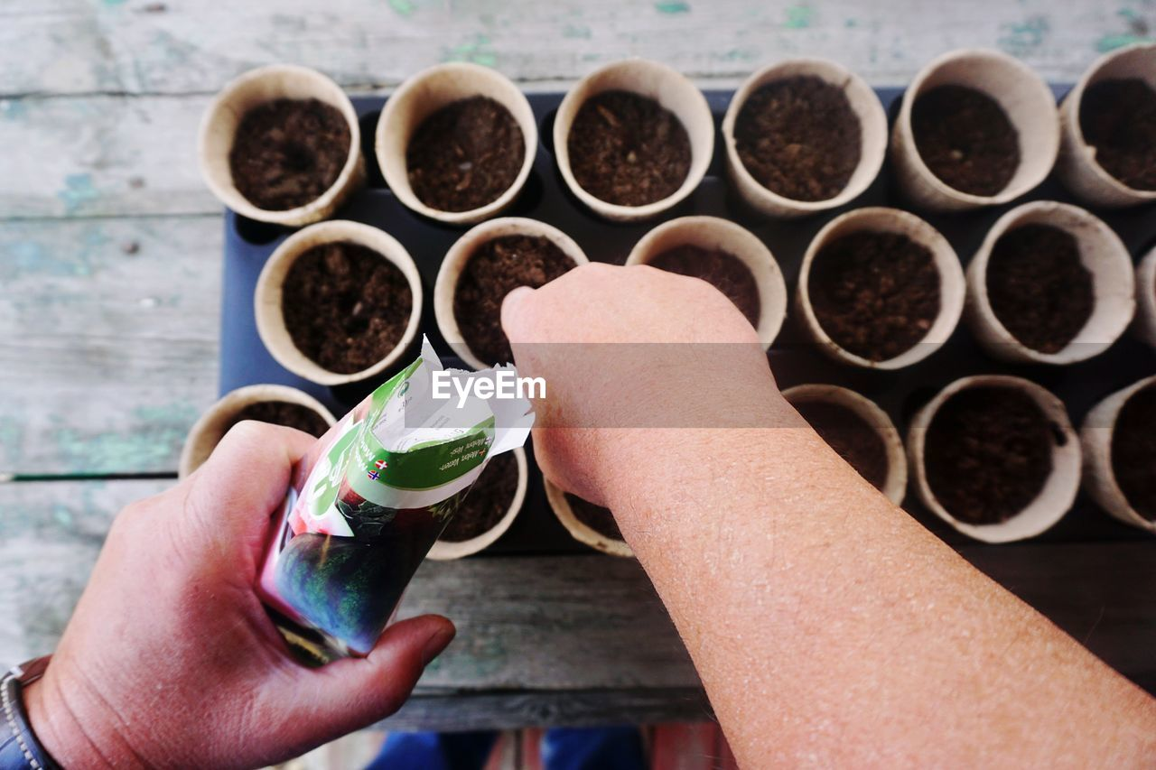 human hand, hand, holding, human body part, real people, one person, lifestyles, drink, food and drink, personal perspective, coffee, unrecognizable person, coffee - drink, body part, refreshment, cup, close-up, day, focus on foreground, finger, gardening, planting