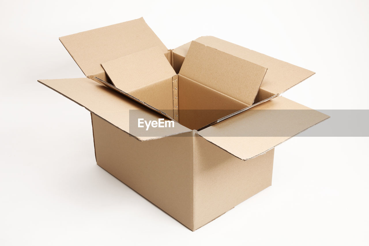 Close-up of cardboard boxes over white background