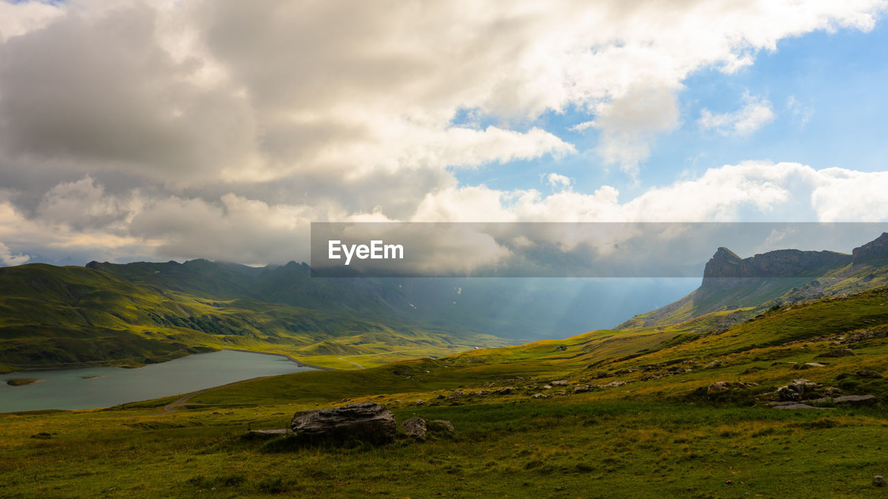 cloud - sky, beauty in nature, sky, scenics - nature, mountain, tranquil scene, tranquility, landscape, environment, non-urban scene, no people, nature, day, grass, idyllic, land, green color, plant, mountain range, outdoors, rolling landscape