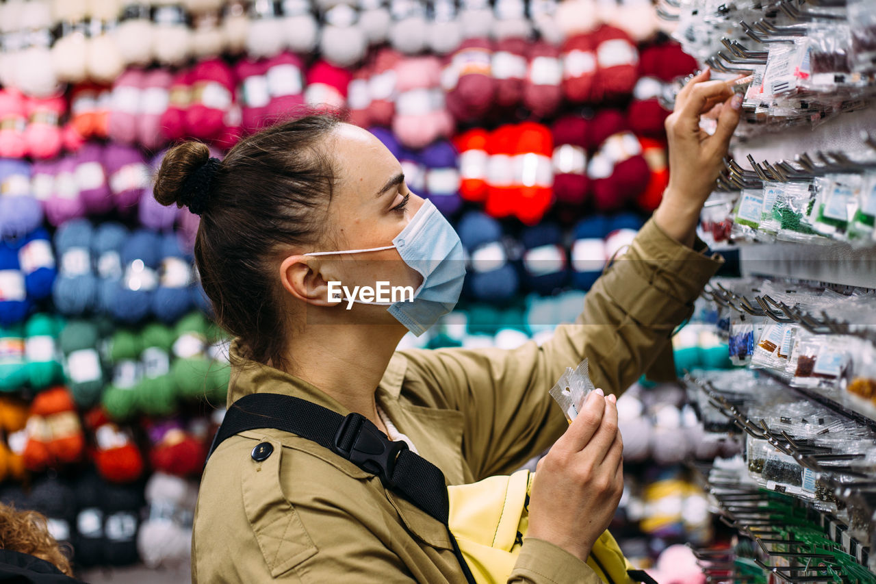 Portrait of woman looking at store