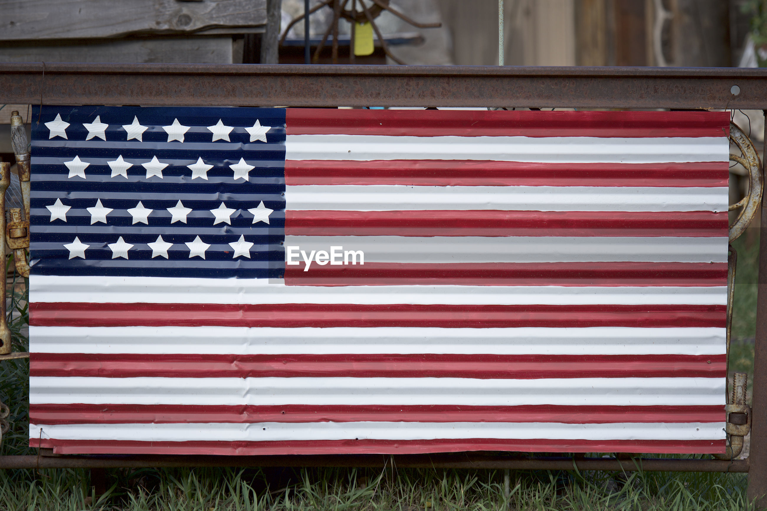 Close-up of corrugated iron american flag
