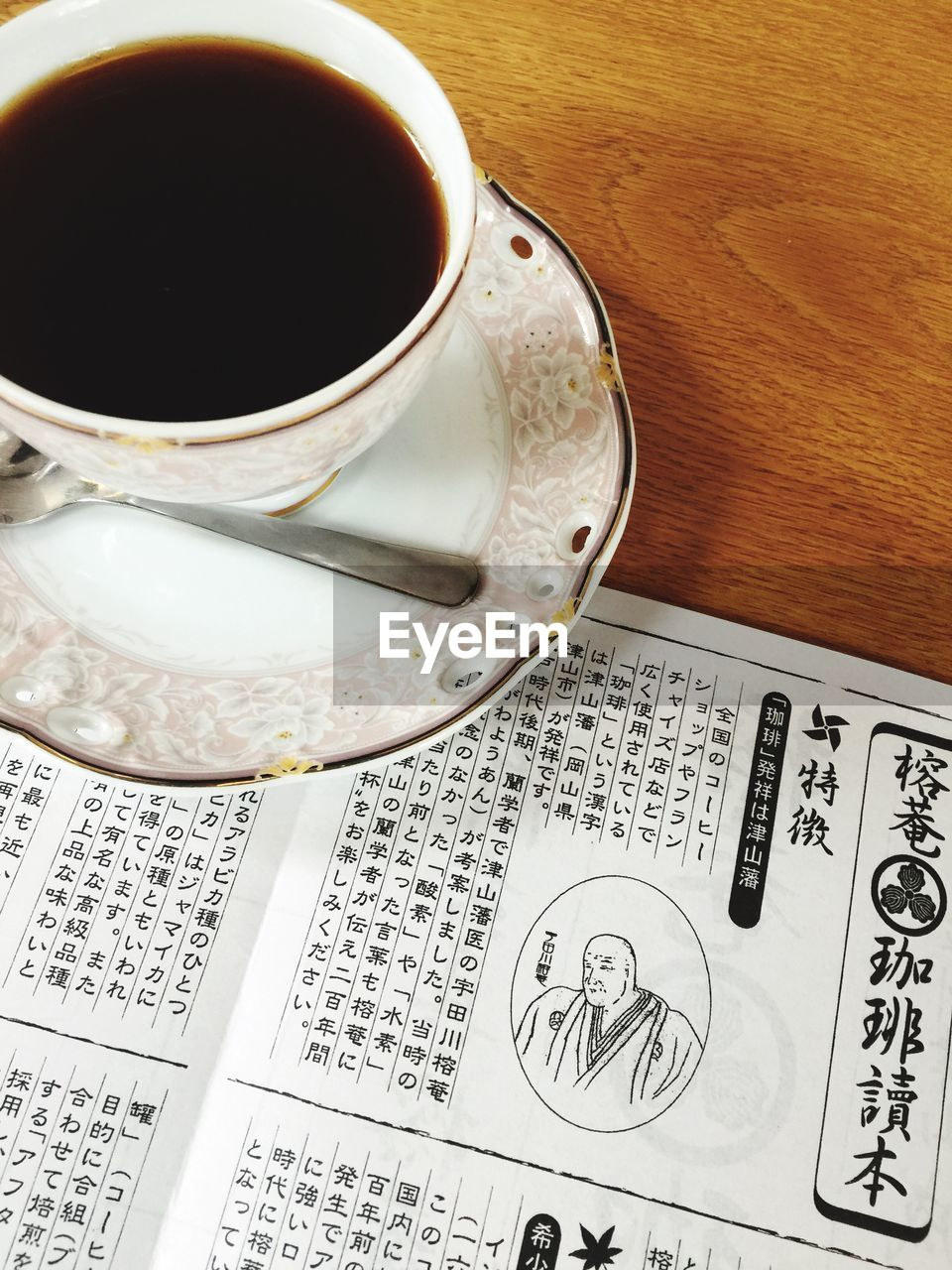 coffee cup, drink, coffee - drink, food and drink, newspaper, table, no people, refreshment, saucer, high angle view, indoors, close-up, day, freshness