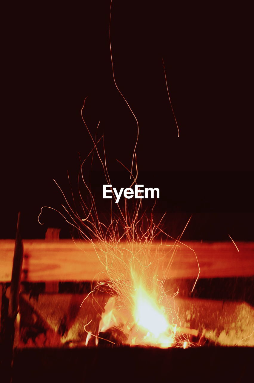 burning, glowing, heat - temperature, night, motion, no people, flame, long exposure, illuminated, close-up, outdoors, bonfire