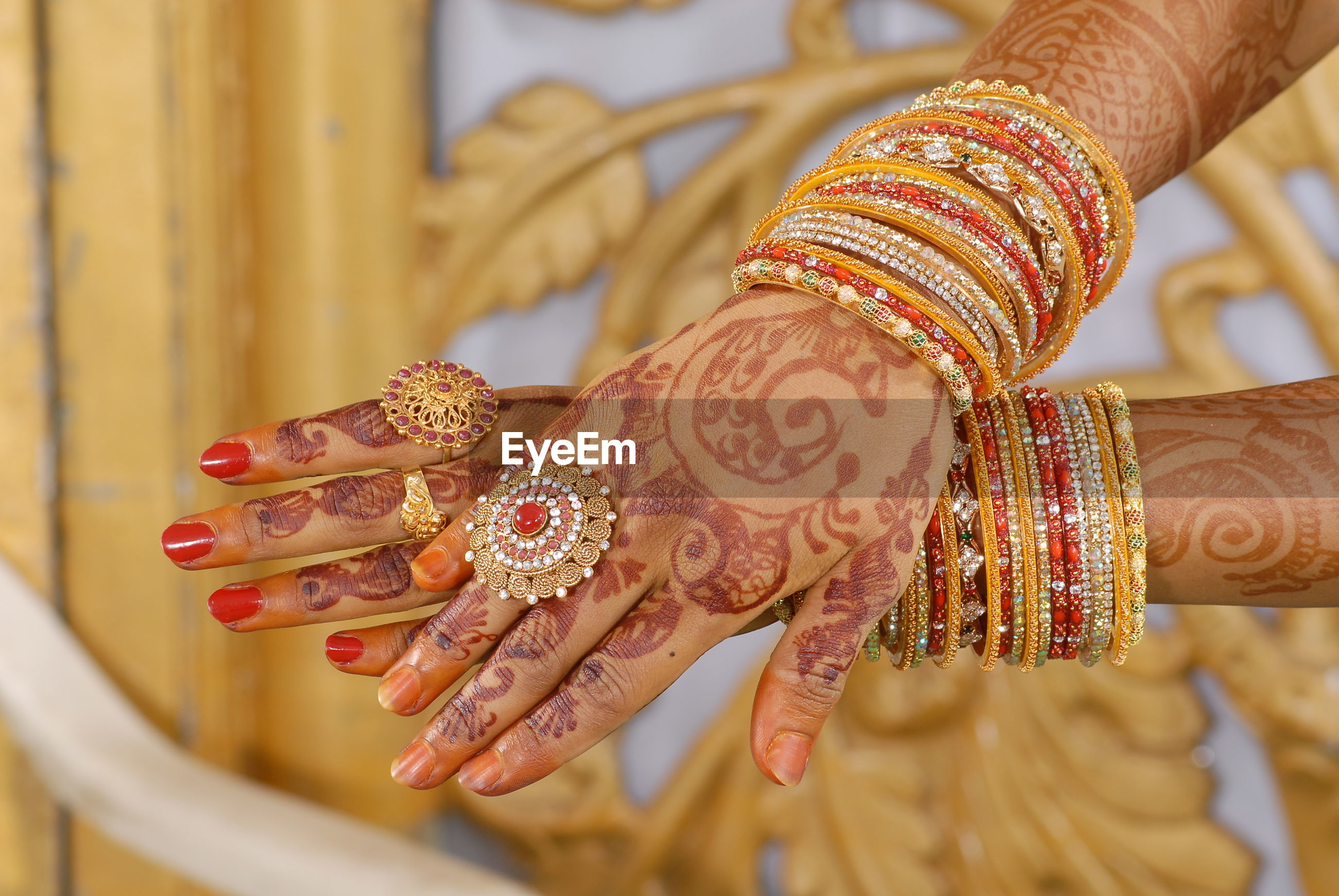 Midsection of bride with henna tattoo