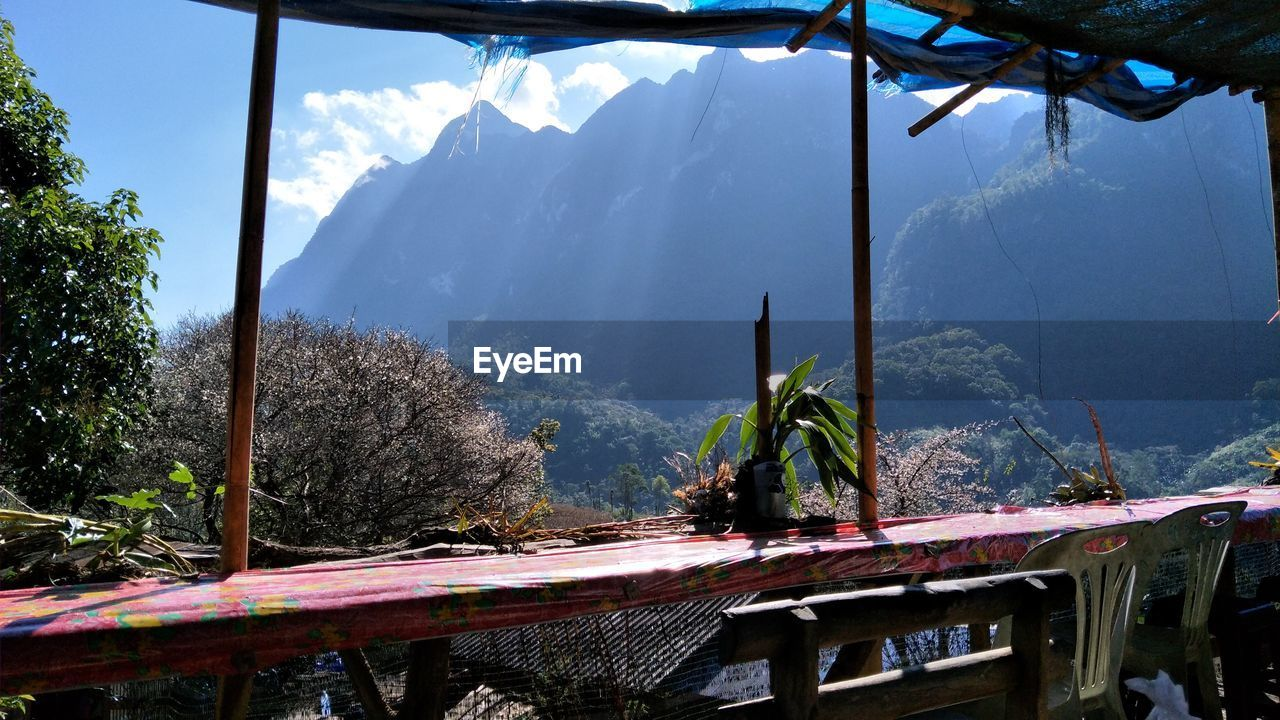 mountain, nature, day, beauty in nature, tree, transportation, mountain range, no people, outdoors, bridge - man made structure, scenics, plant, sky, water