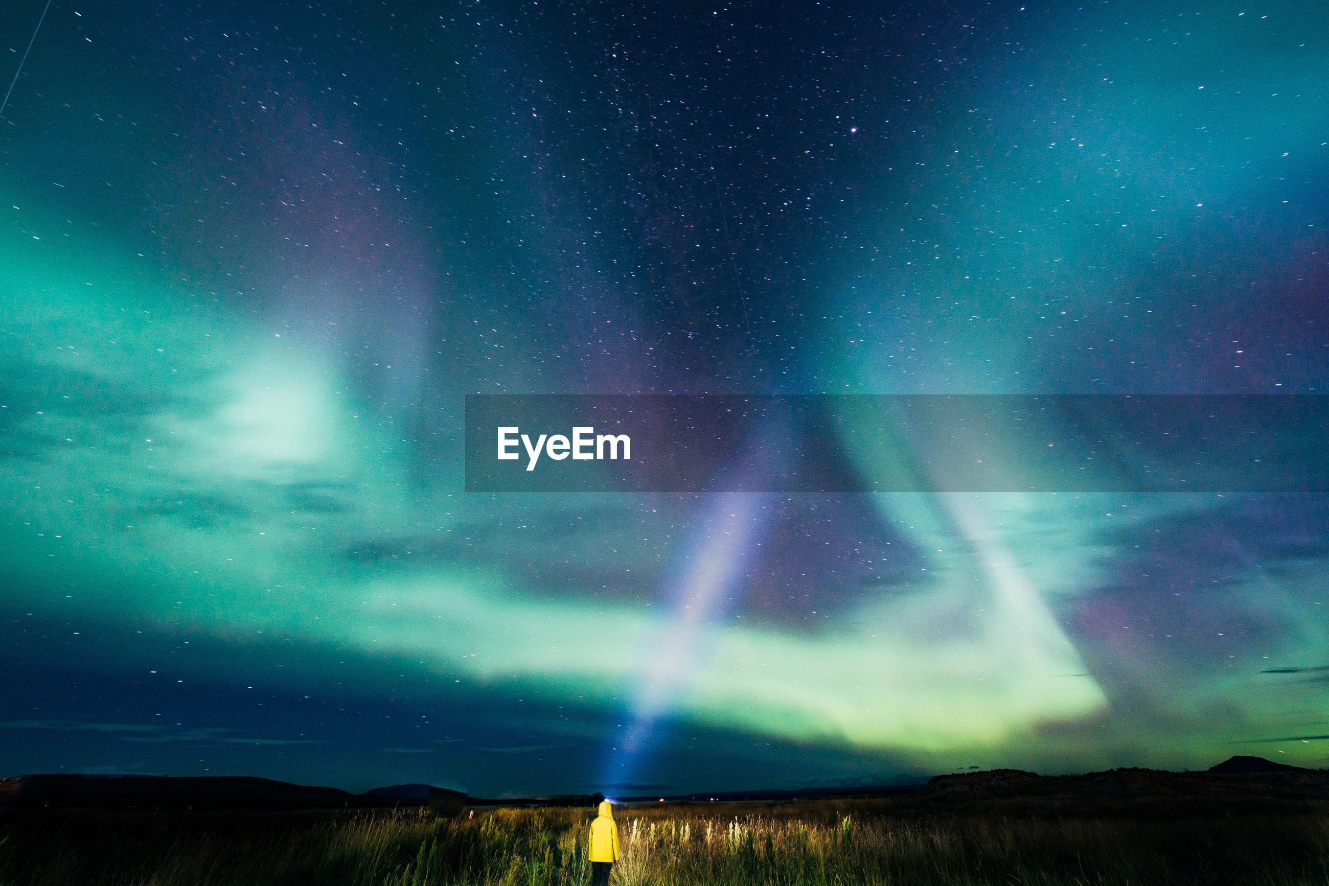 Young woman looking at aurora