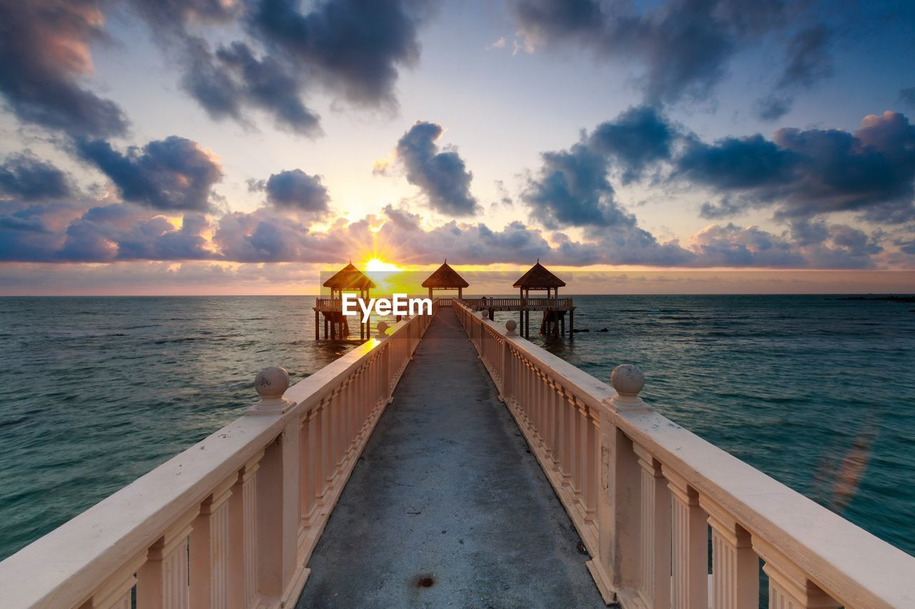sea, water, sunset, sky, horizon over water, scenics, nature, beauty in nature, tranquil scene, cloud - sky, tranquility, the way forward, sunlight, outdoors, beach, no people, jetty, day