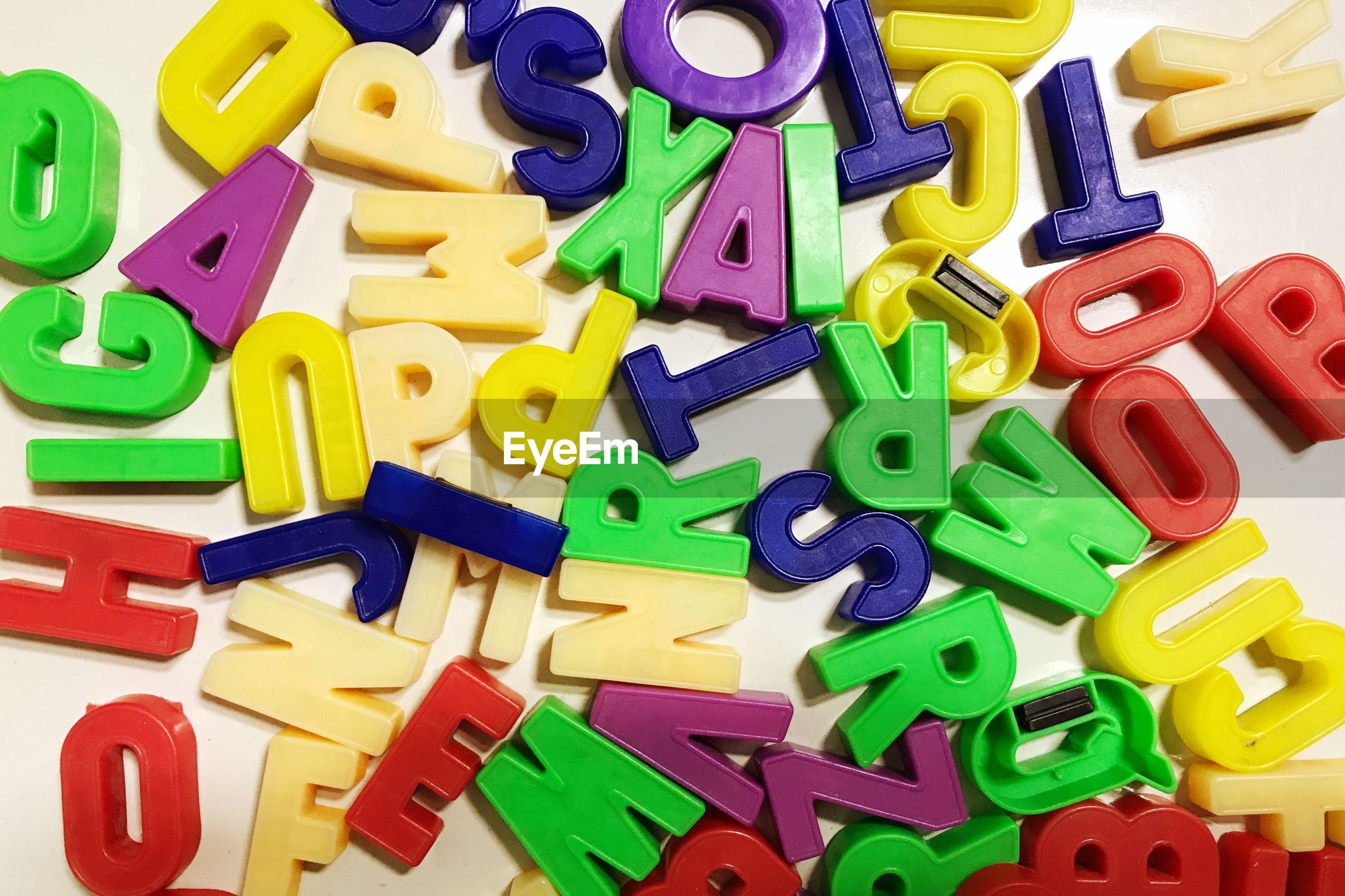 Full frame shot of colorful alphabet toys on table