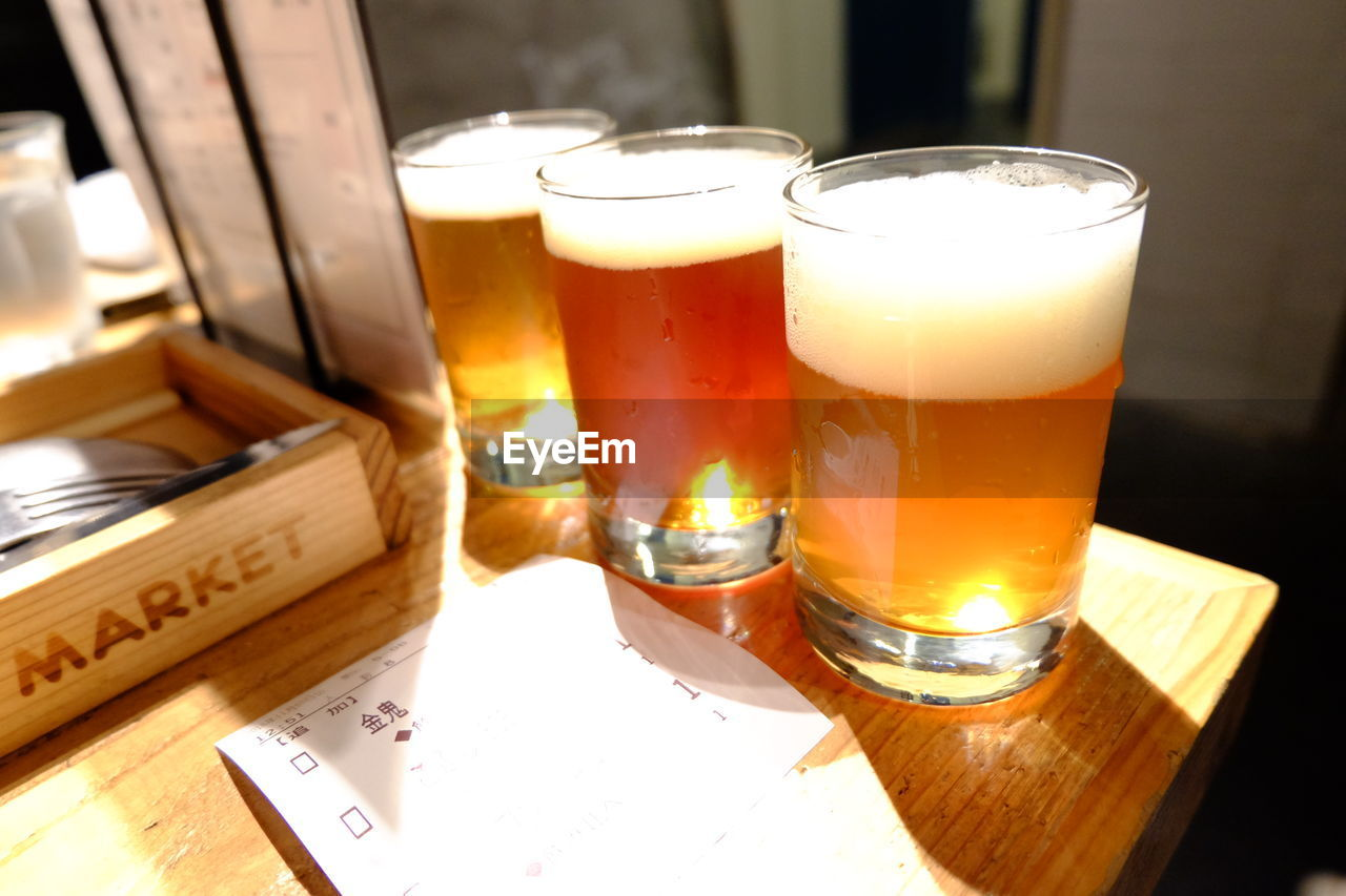 drink, table, refreshment, food and drink, glass, still life, drinking glass, alcohol, no people, indoors, household equipment, beer, freshness, beer - alcohol, wood - material, close-up, transparent, glass - material, beer glass, food, tray