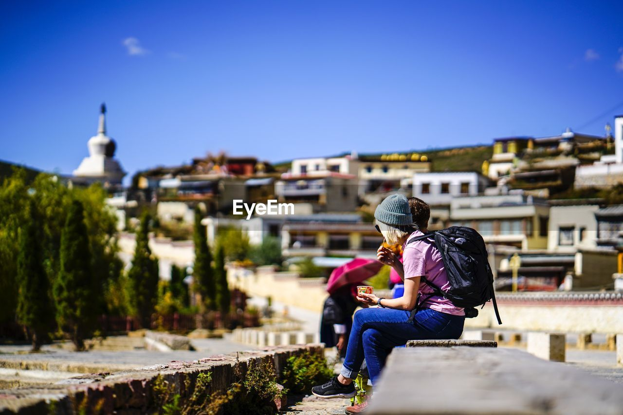 real people, two people, built structure, building exterior, architecture, men, lifestyles, togetherness, sky, adult, people, women, leisure activity, nature, bonding, day, love, casual clothing, sitting, positive emotion, outdoors, couple - relationship