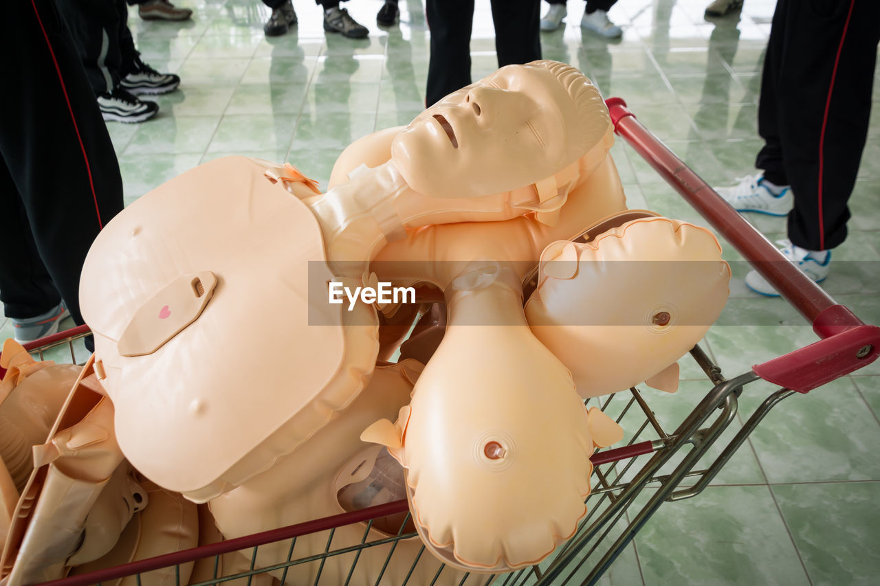 Close-up of cpr dummy on trolley