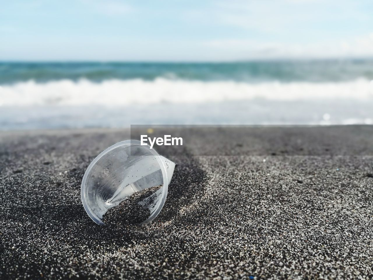 land, beach, sea, water, sky, nature, no people, sand, focus on foreground, day, glass - material, transparent, close-up, beauty in nature, horizon, horizon over water, outdoors, shell, tranquility