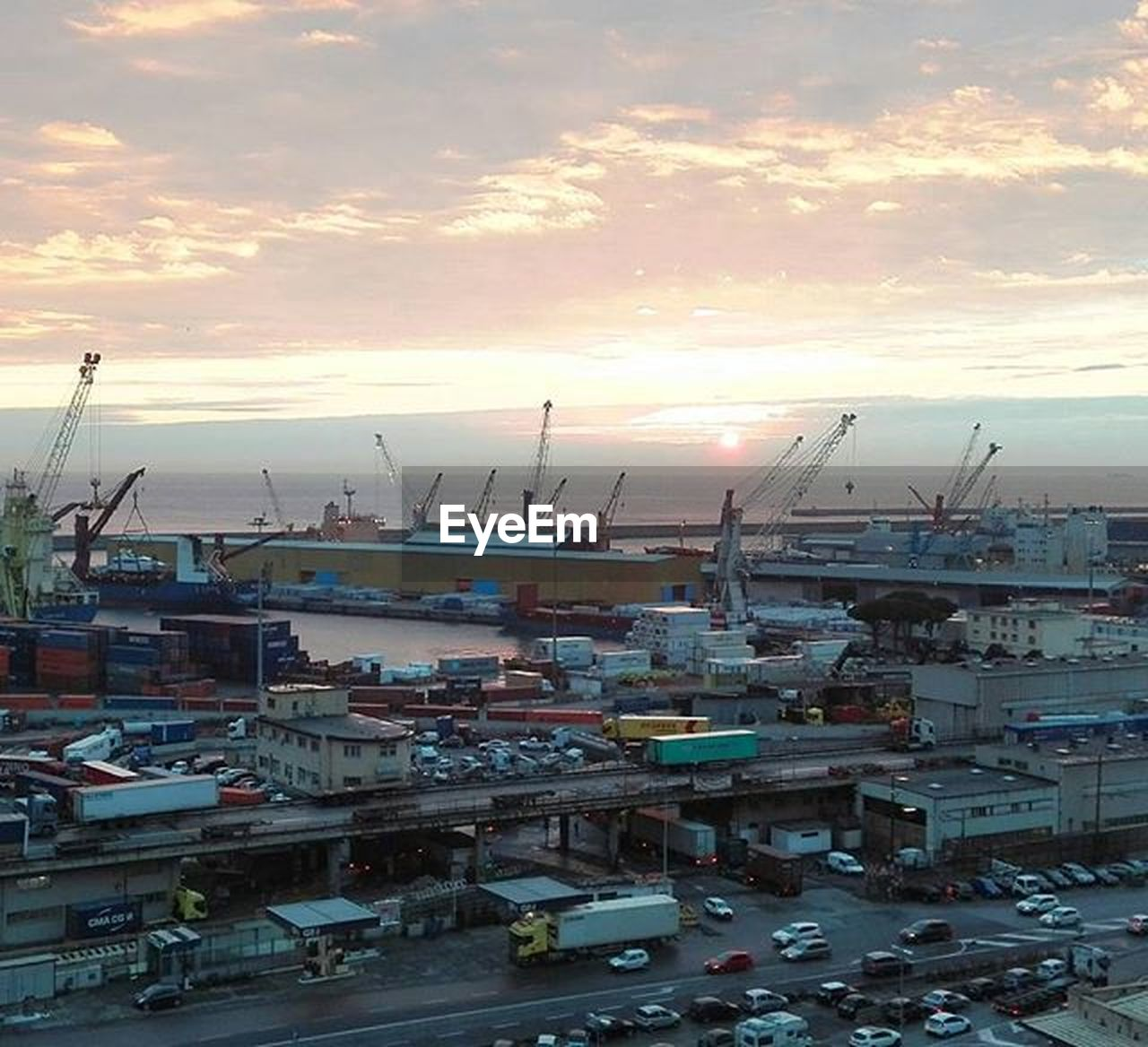 sunset, crane - construction machinery, transportation, sky, harbor, architecture, no people, mode of transport, building exterior, development, city, outdoors, cloud - sky, commercial dock, high angle view, built structure, nautical vessel, freight transportation, cityscape, industry, nature, shipyard, day