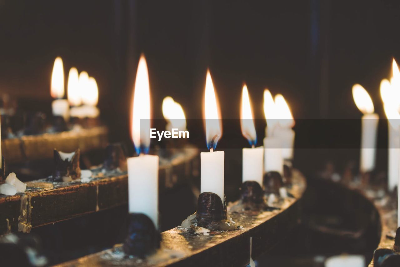 Close-Up Of Candles In Church