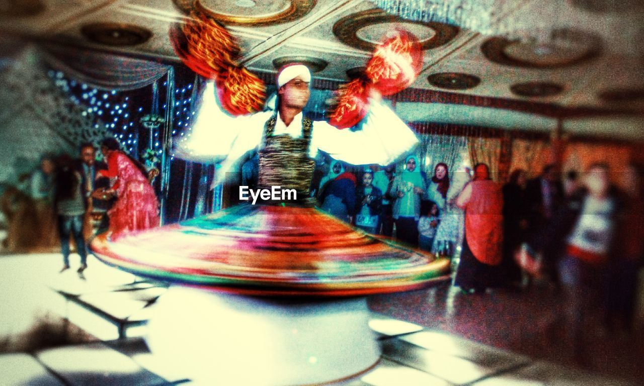 indoors, blurred motion, arts culture and entertainment, motion, no people, carousel, close-up, day