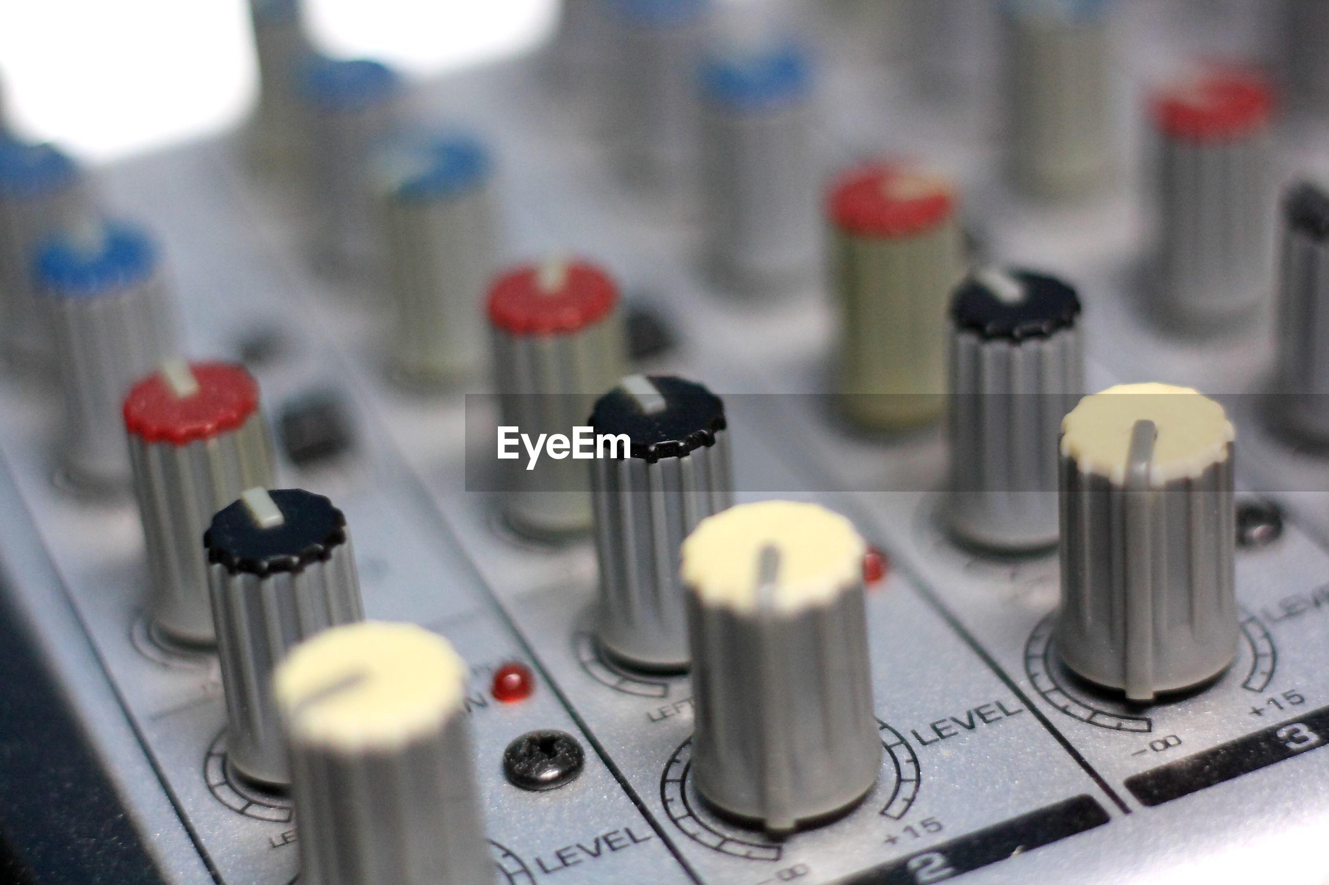 Close-up of knob on sound mixer