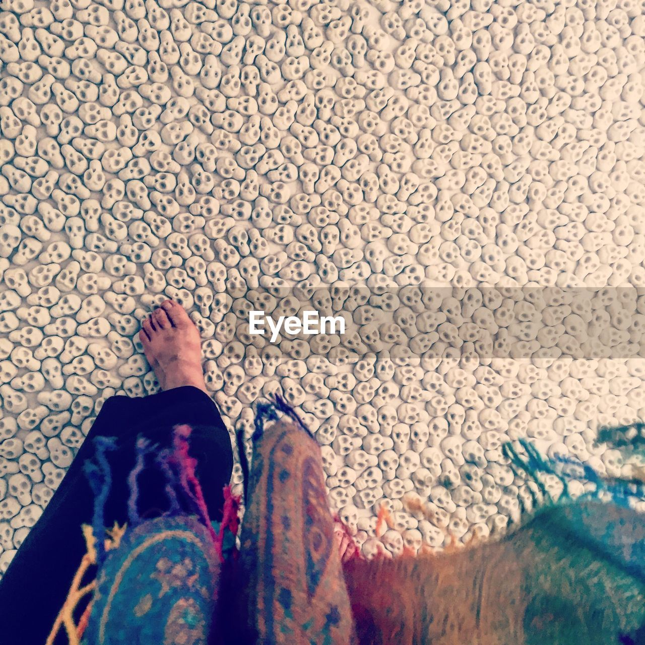low section, human leg, human body part, one person, body part, real people, standing, personal perspective, shoe, lifestyles, adult, high angle view, human foot, women, leisure activity, day, directly above, human limb, pattern, jeans, floral pattern