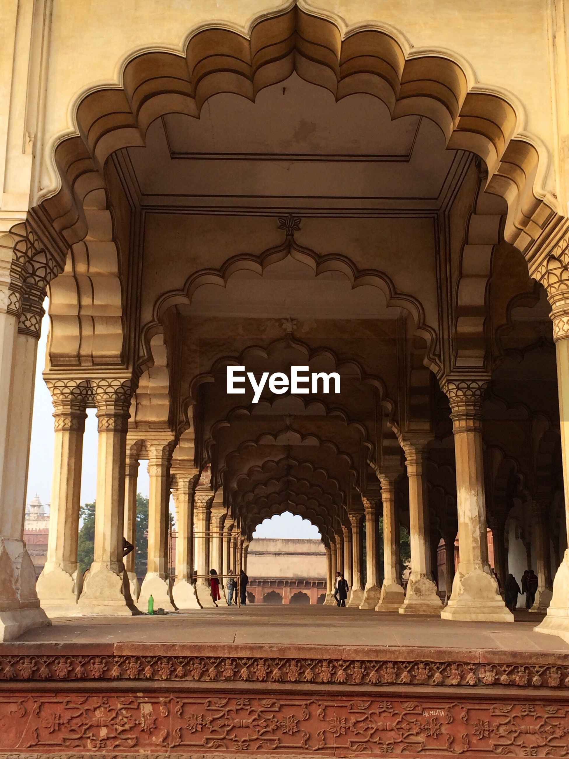 architecture, built structure, indoors, arch, history, architectural column, famous place, art and craft, travel destinations, ornate, tourism, ceiling, in a row, art, column, colonnade, travel, ancient, low angle view, carving - craft product