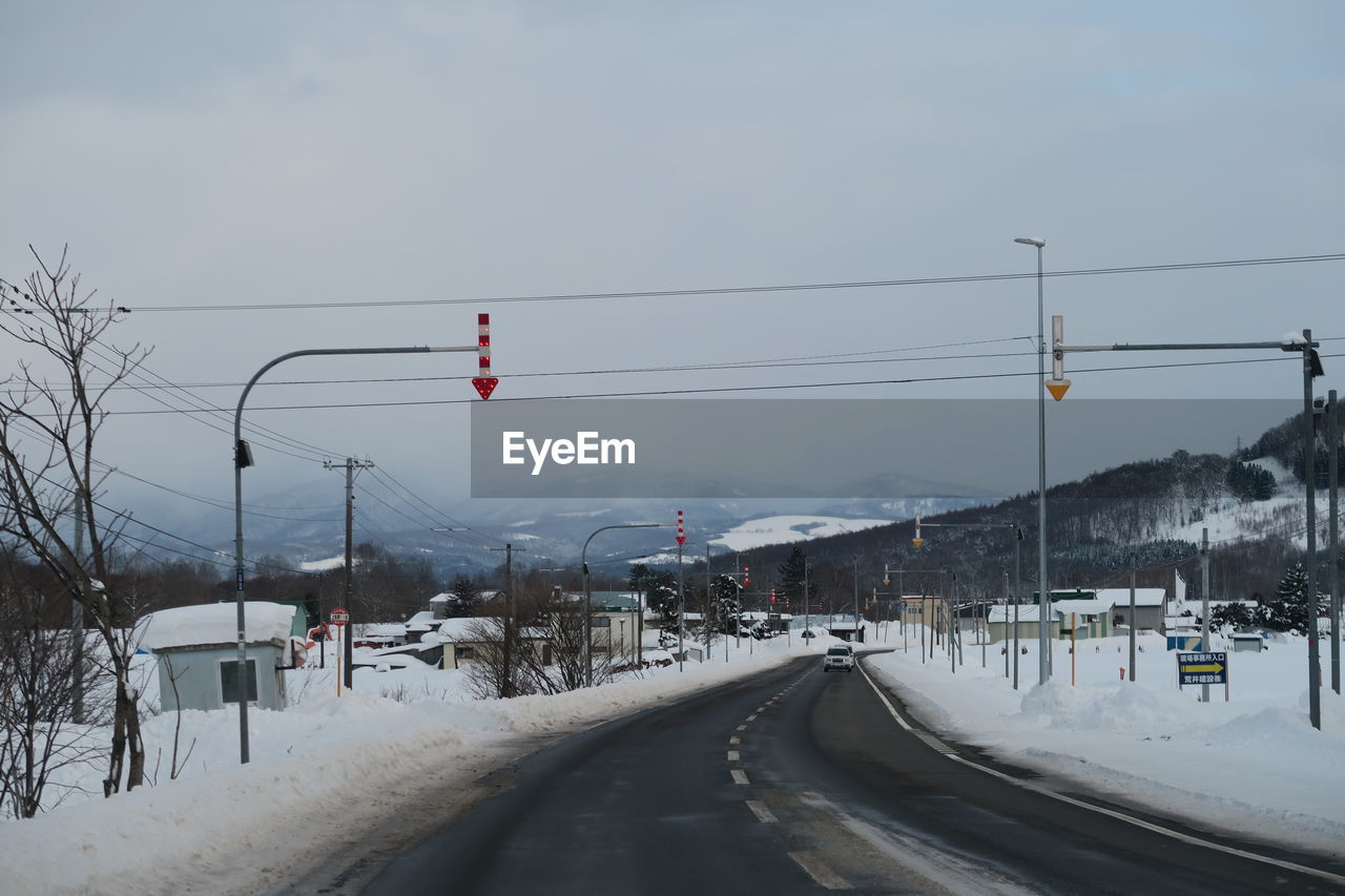 winter, cold temperature, snow, transportation, sky, road, nature, cable, direction, mode of transportation, electricity, white color, covering, mountain, day, technology, beauty in nature, the way forward, no people, outdoors, snowcapped mountain