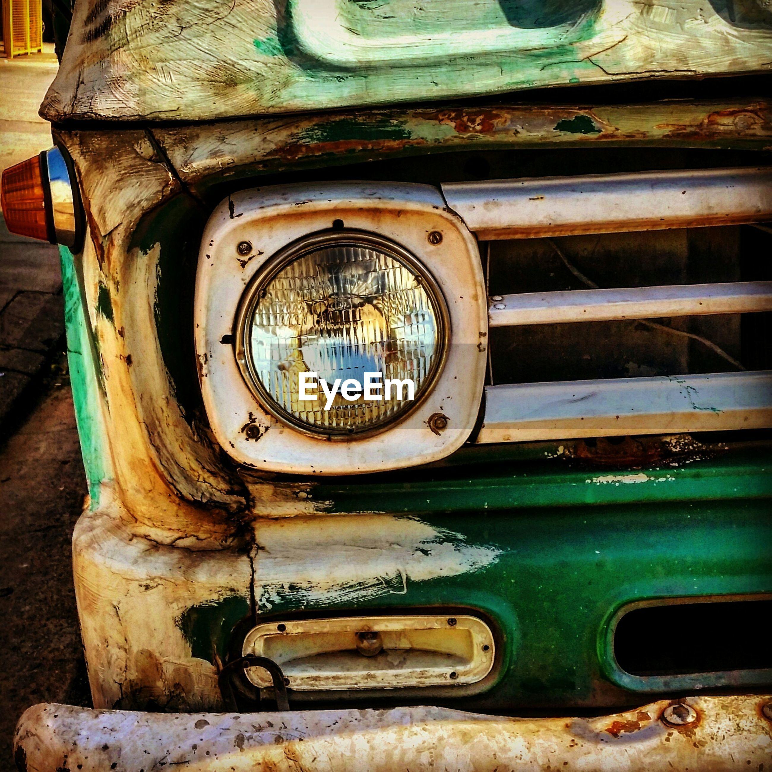 Close-up of abandoned truck headlight