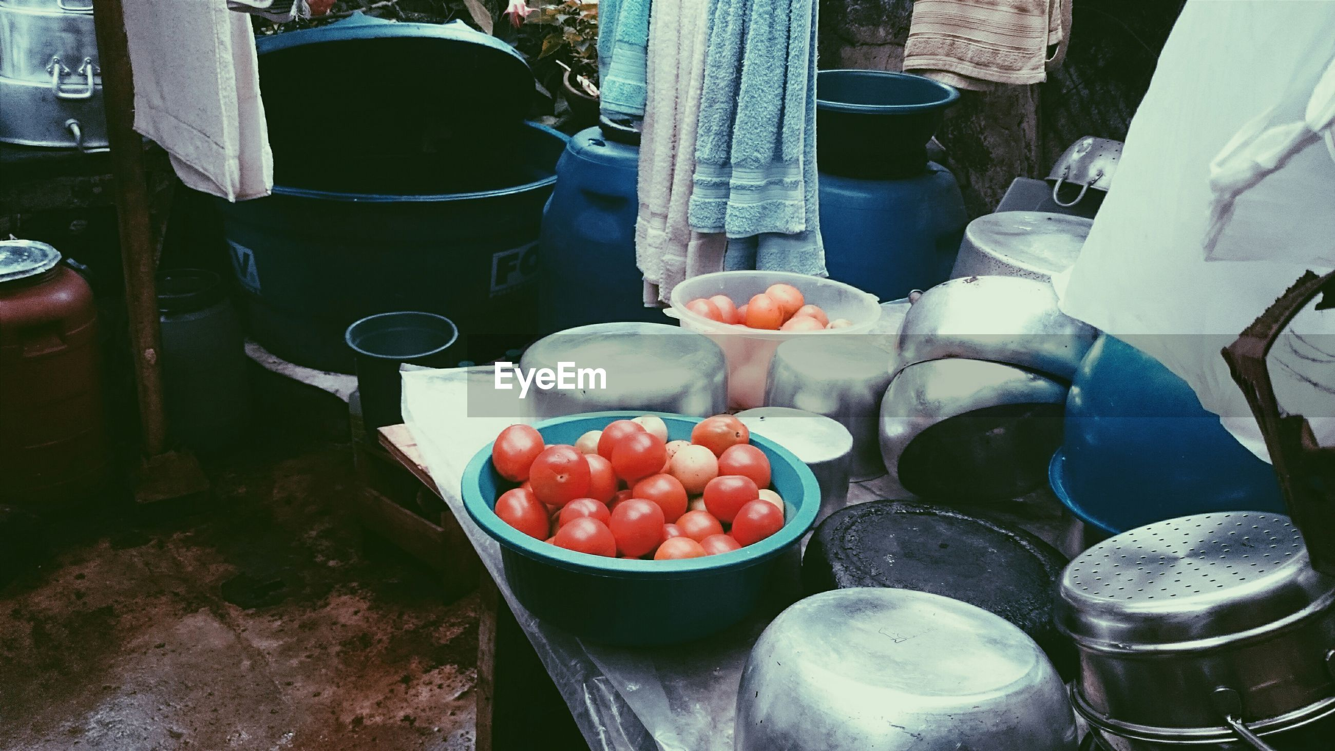 High angle view of containers and tomatoes on market stall
