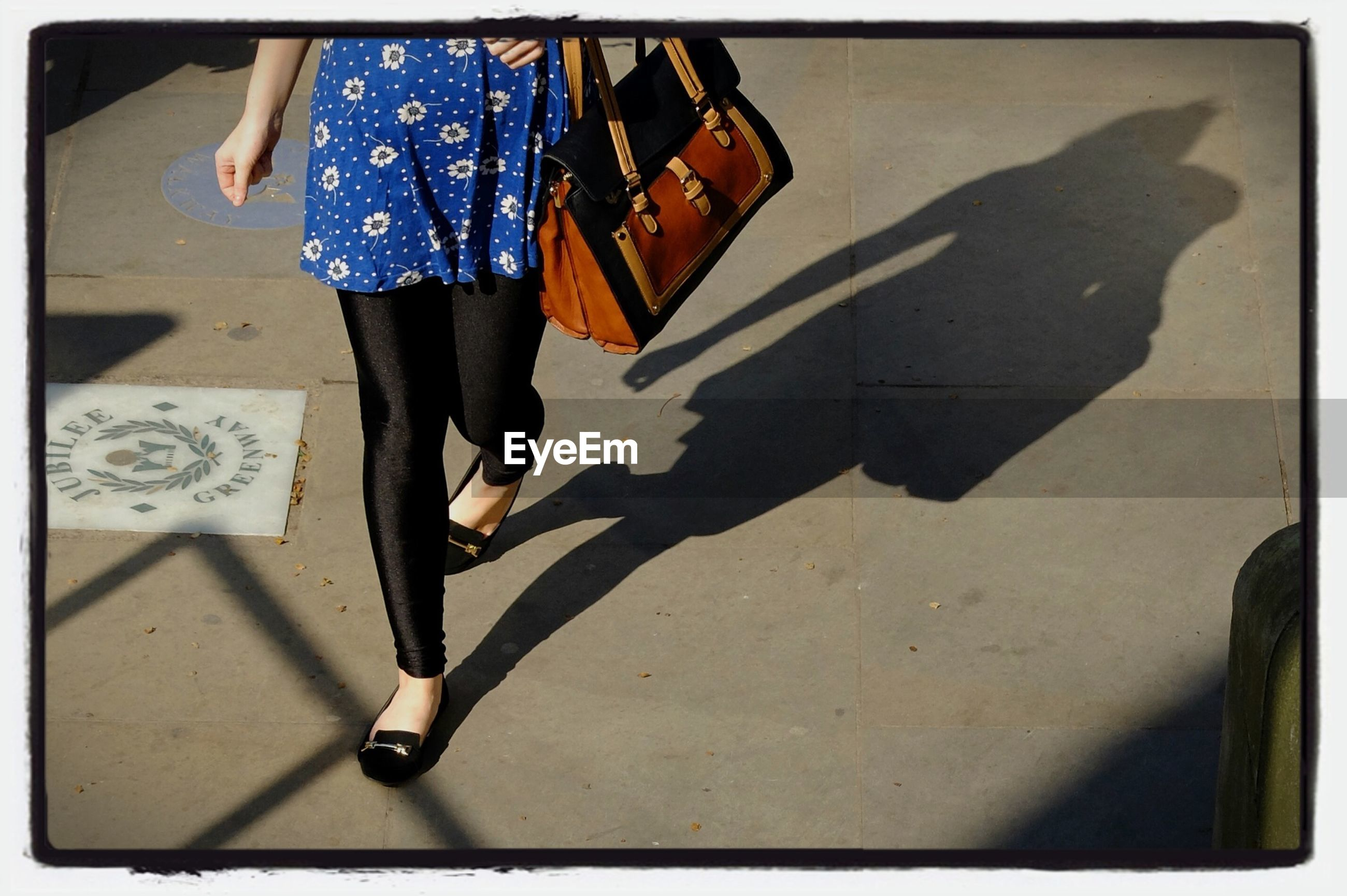 transfer print, low section, lifestyles, auto post production filter, person, men, walking, street, full length, leisure activity, standing, casual clothing, shadow, sidewalk, sunlight, day