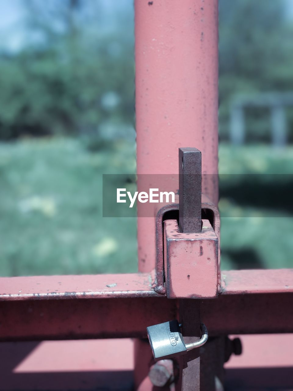 metal, close-up, focus on foreground, outdoors, day, no people, sunlight, rusty, red, latch