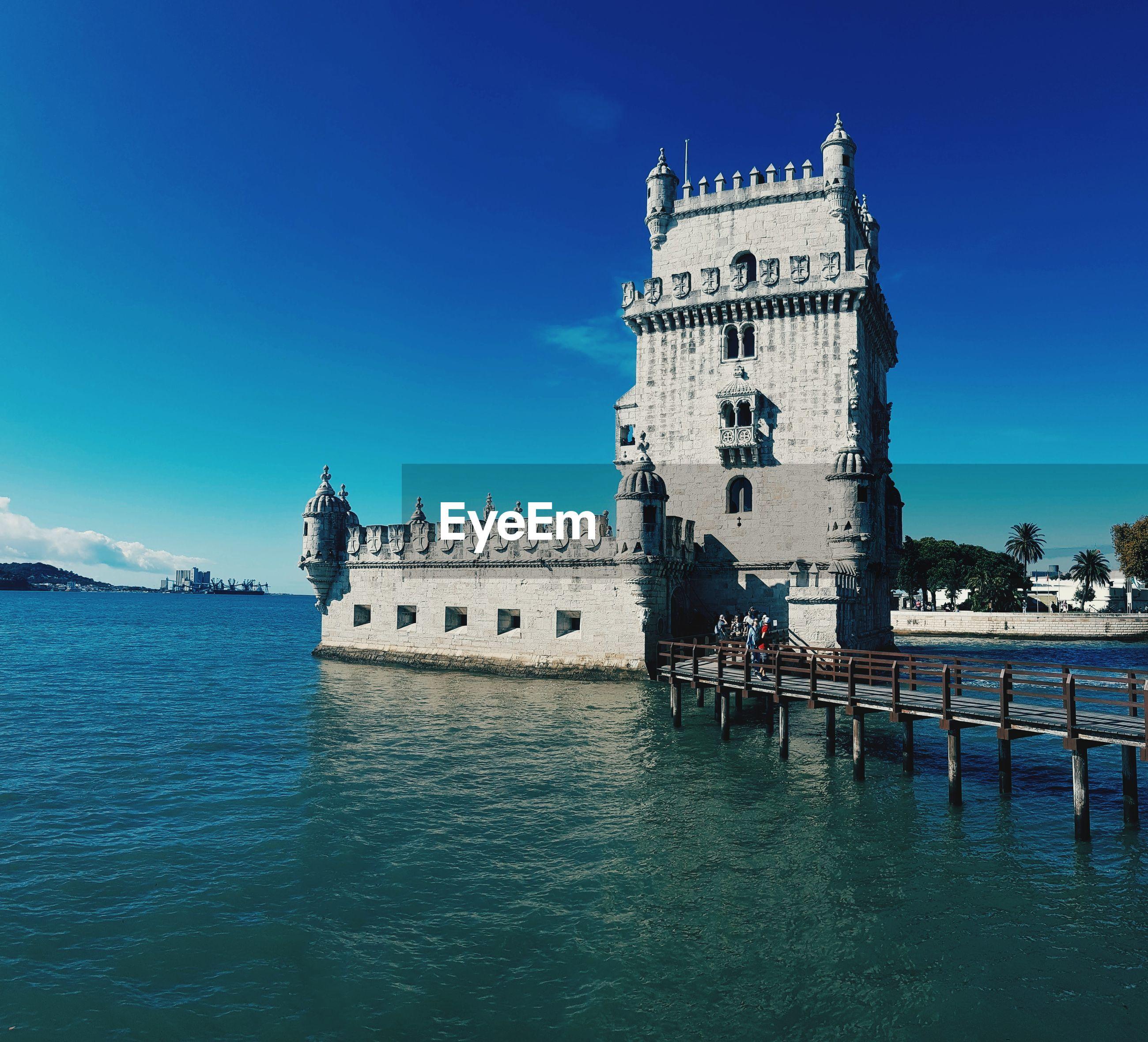 Historic building in venetian lagoon against blue sky