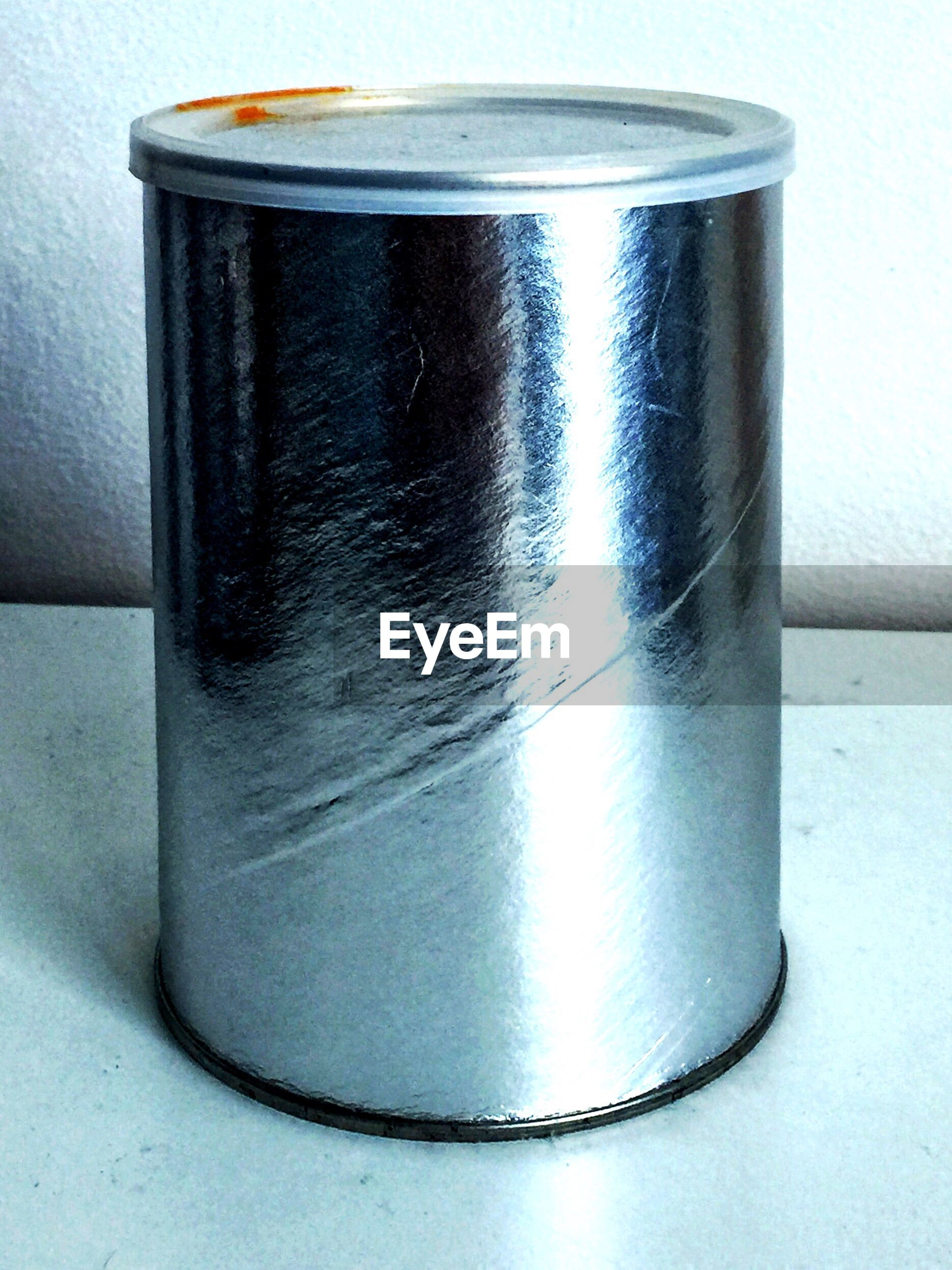 Close-up of metal container on table