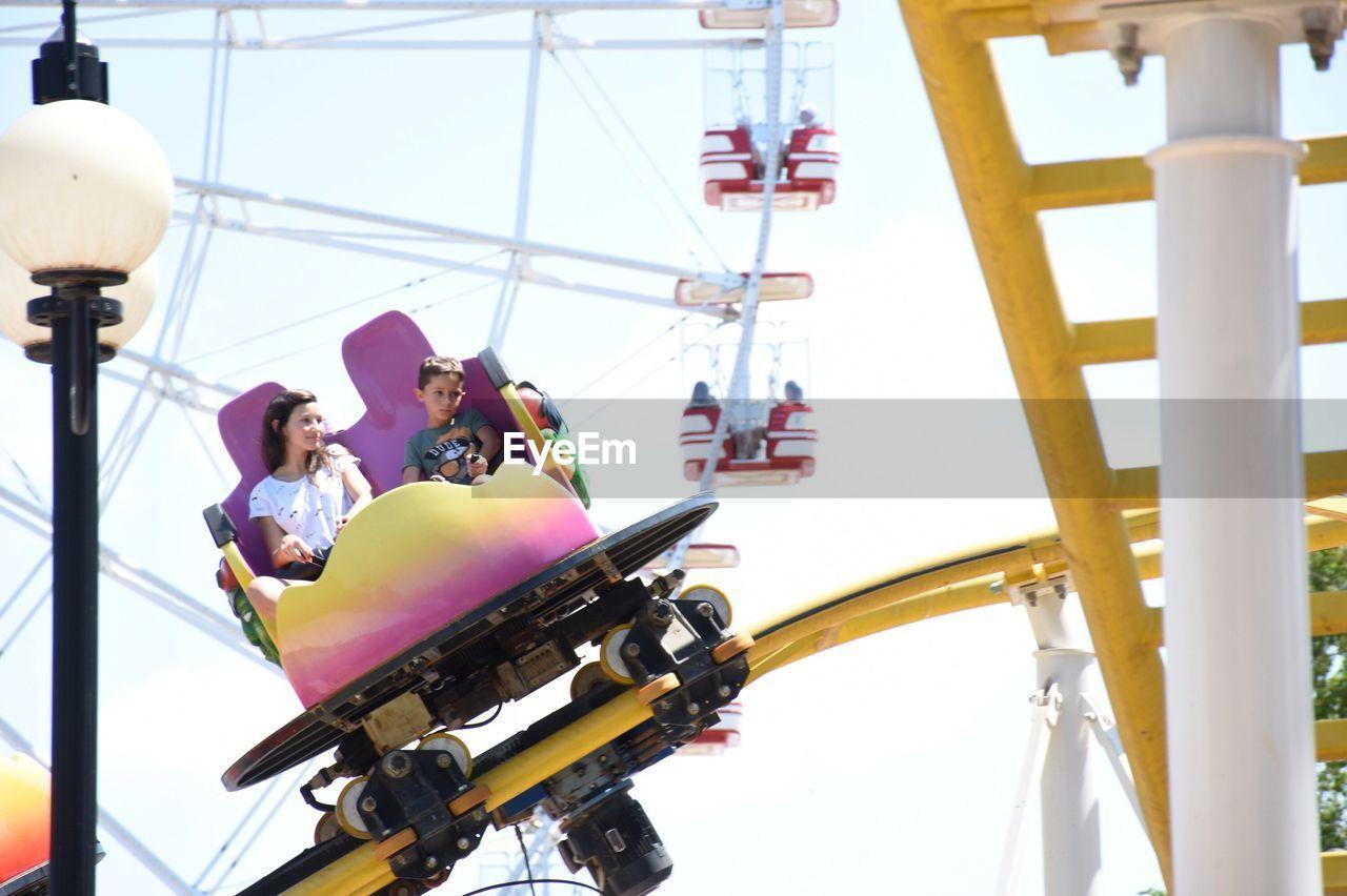 Children Having Fun In Amusement Park