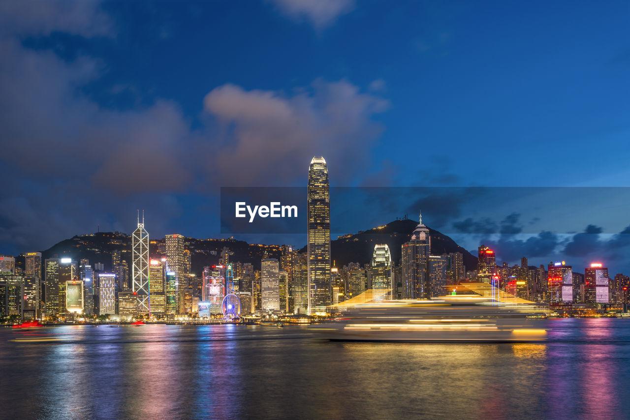 SCENIC VIEW OF HONG KONG SKYLINE AT NIGHT