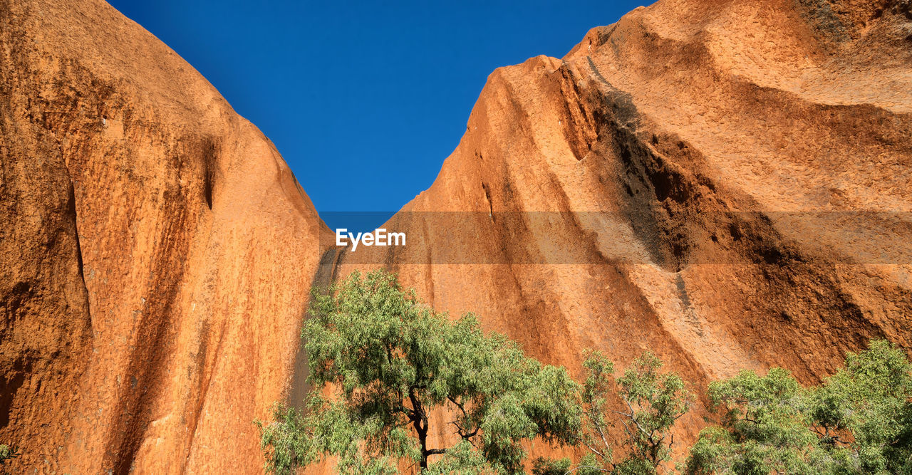 Scenic view of rock formations in desert against sky
