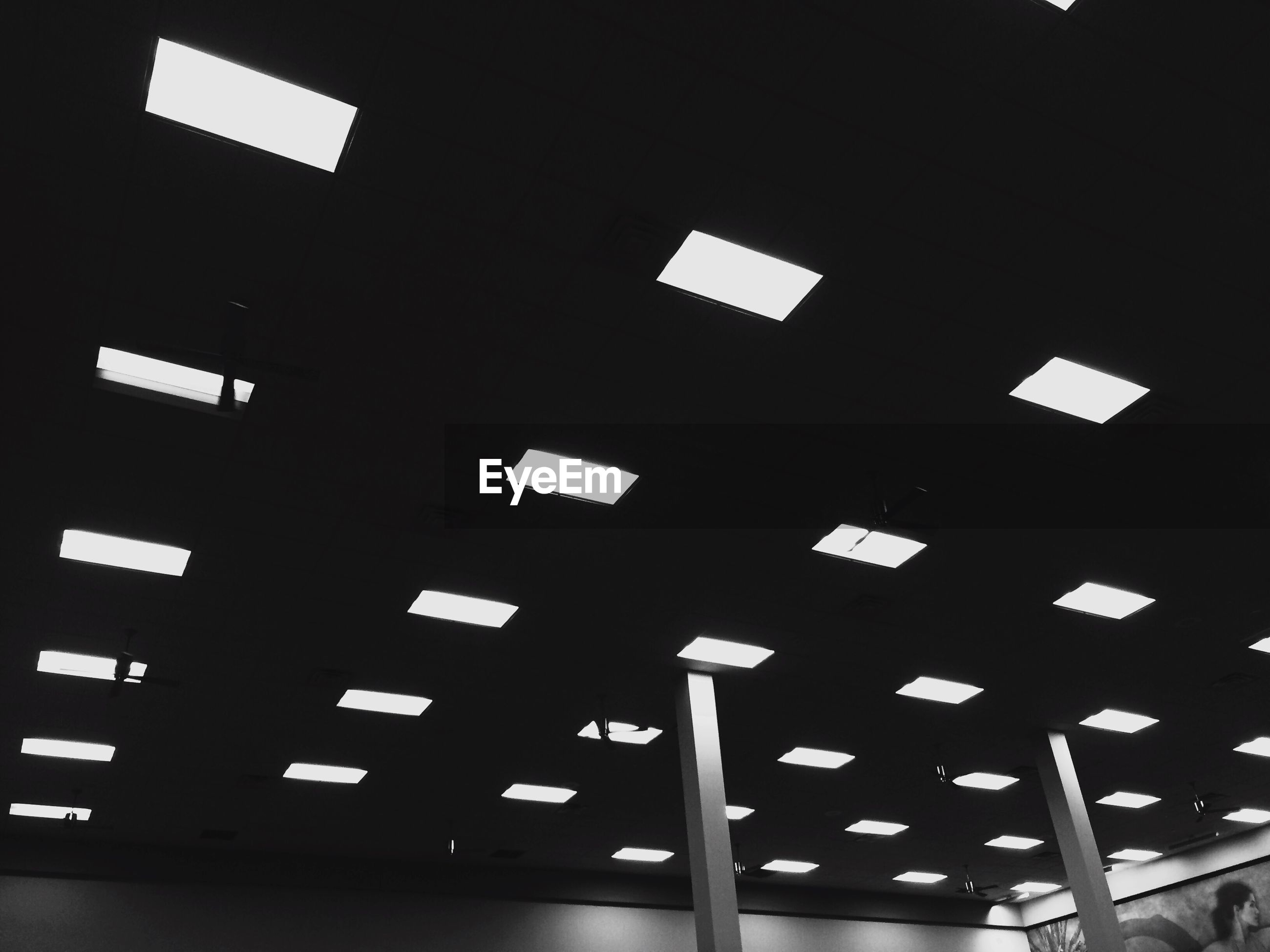 Low angle view of illuminated lights on ceiling